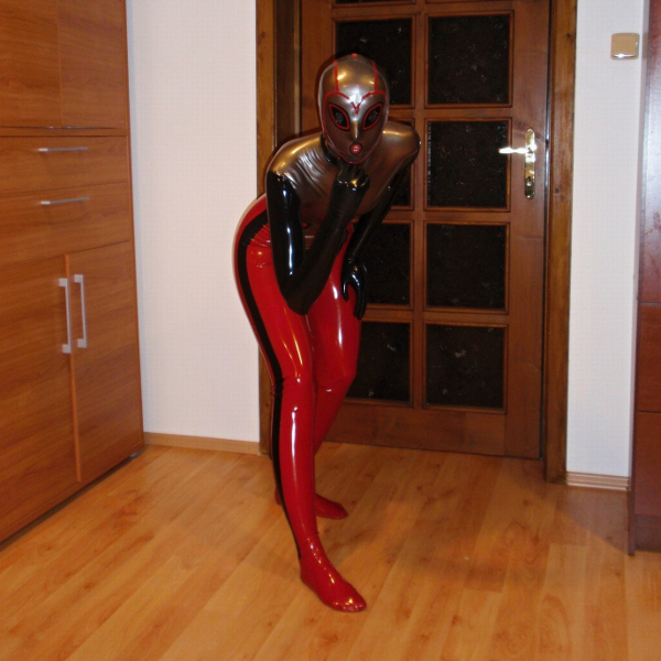 very interesting latex catsuit with custom color scheme , attached mask , gloves and socks
